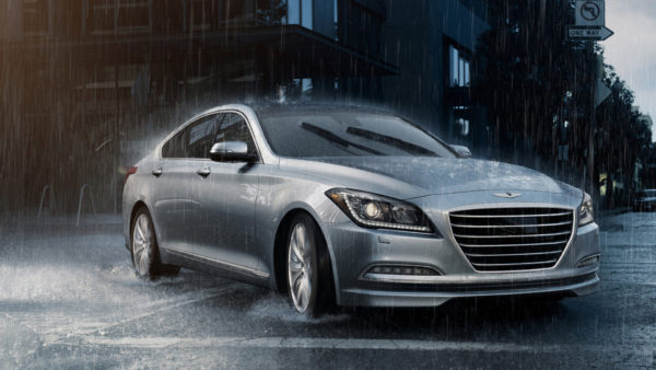 Hyundai G80 on city street in the rain