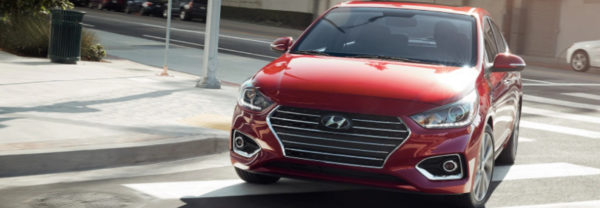 Red 2019 Hyundai Accent rounding a street corner