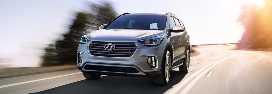 Silver 2019 Hyundai Santa Fe driving down highway