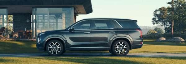 2020 Hyundai Palisade in silver parked in the driveway of a modern home.